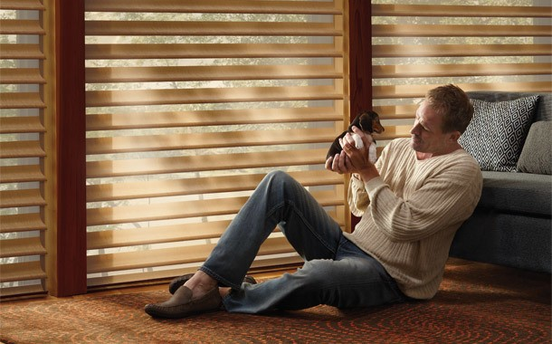 Man sitting in front of shutters